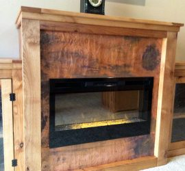 custom furniture // copper accents // handmade fireplace cabinet by Mike Dumas Copper Designs.