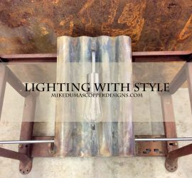 Metal lighting with an industrial style by Mike Dumas Copper Designs.